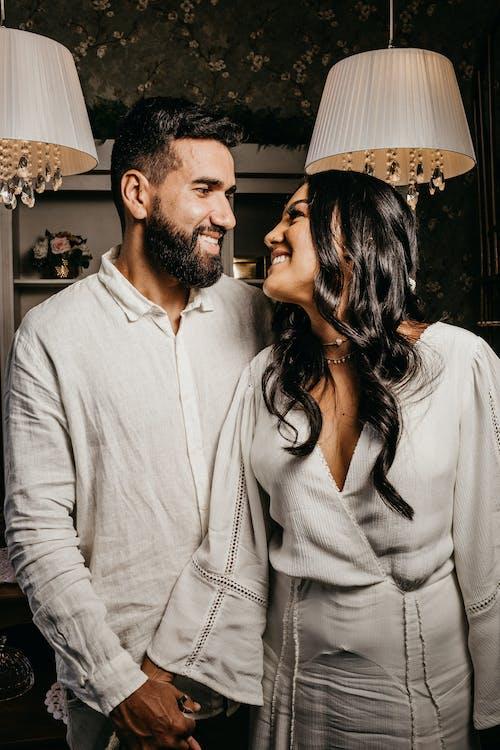 Content ethnic newlywed couple interacting on wedding day