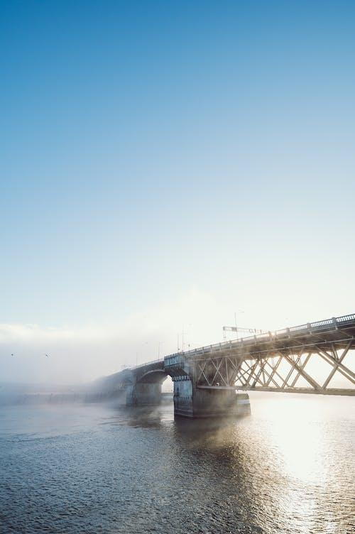 Bridge over Water Under Blue Sky