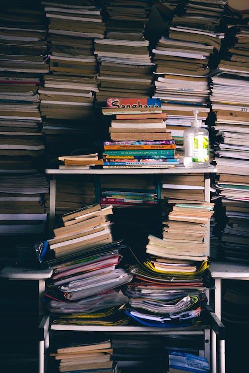 Stacked books on shelves