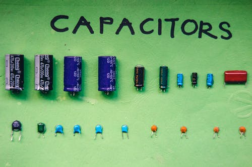Collection of capacitors on green surface