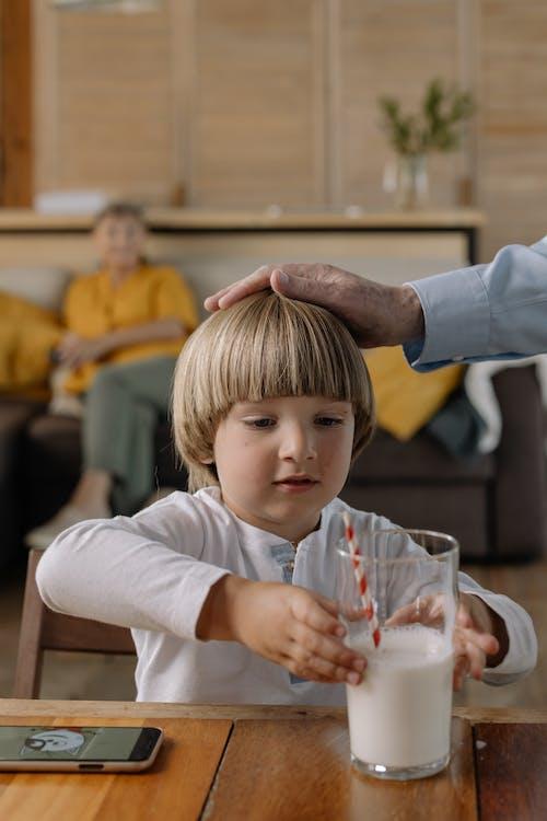 Boy Holding a Glass of Milk