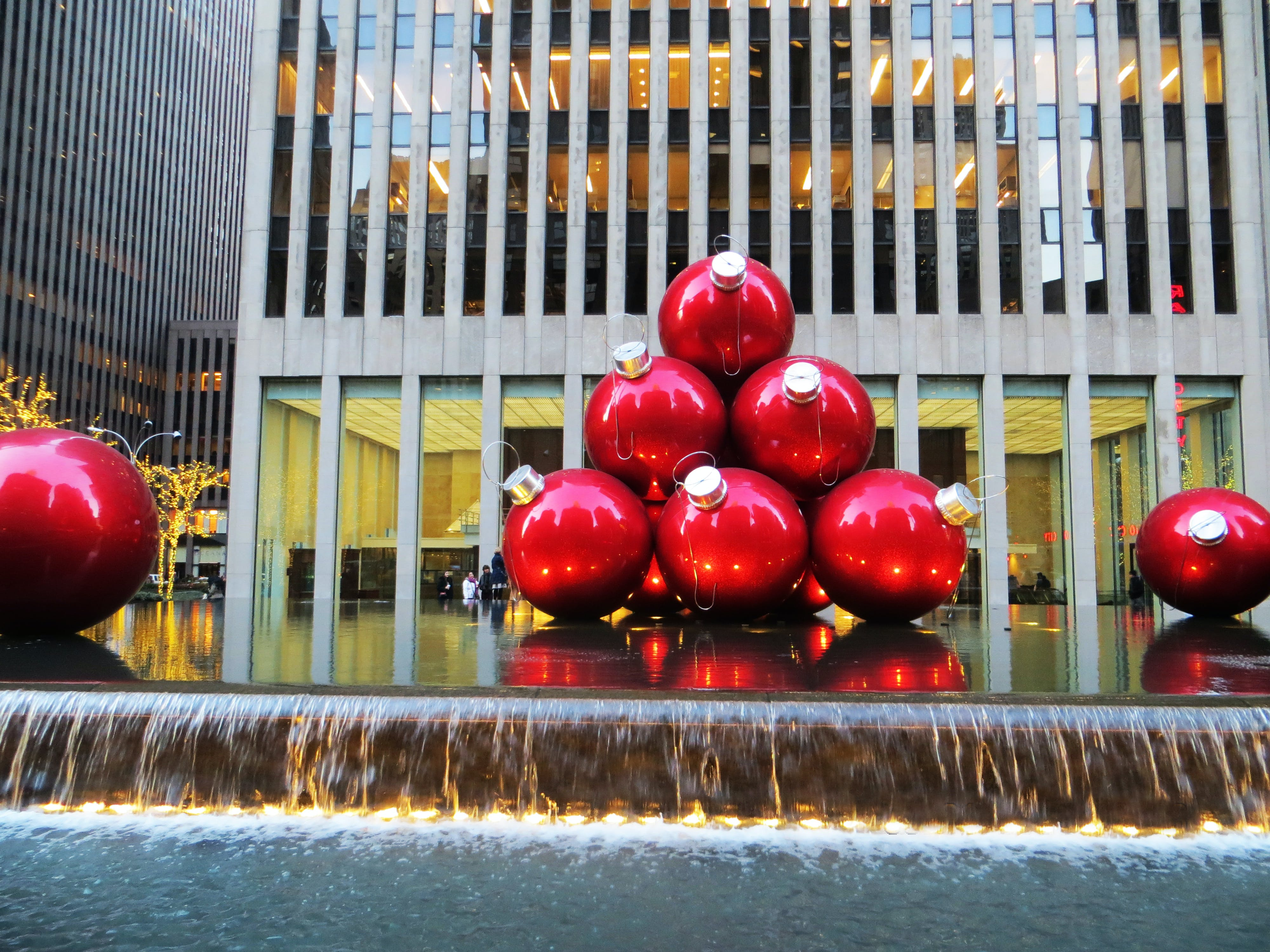 Red Baubles Near Grey High-rise Building