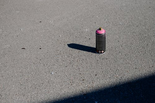Black and Pink Labeled Bottle