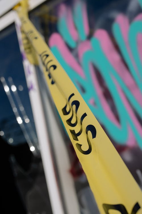 Close-Up Shot of Police Tape