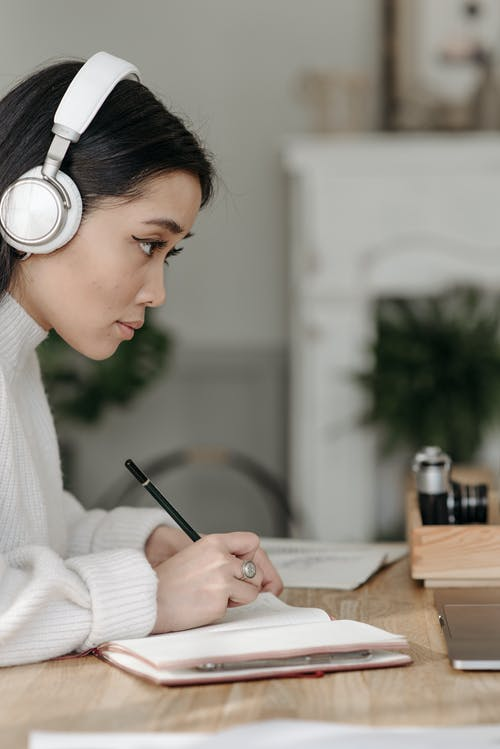 Young Woman on Head Phone Studying