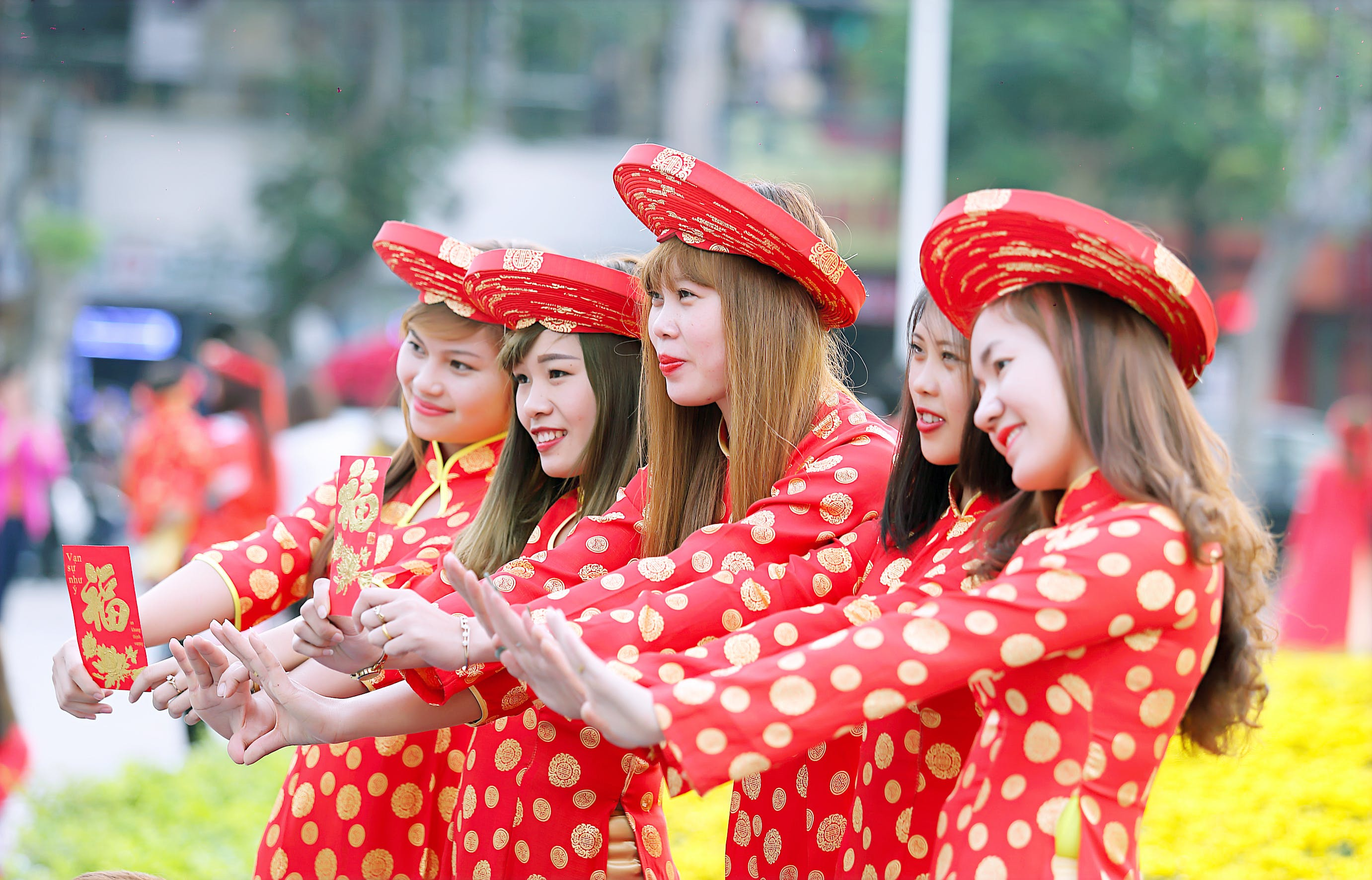 Five Women In Red And White Polka Dot Cheongsam Dress Standing