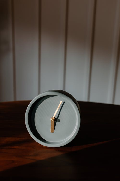 White and Black Round Plate on Brown Wooden Table