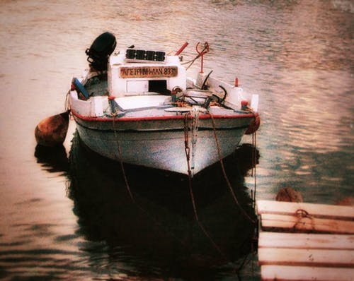 Free stock photo of anchored, boat, light reflections