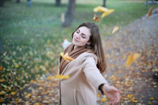 Woman Open Arms While Closed-eyes Smiling Photo