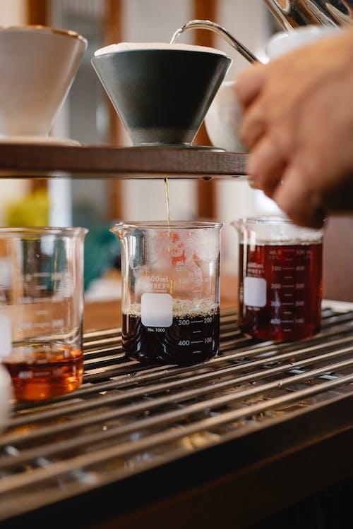 Faceless barista preparing pour over coffee