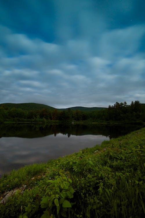 Free stock photo of clouds, night, pond, stars