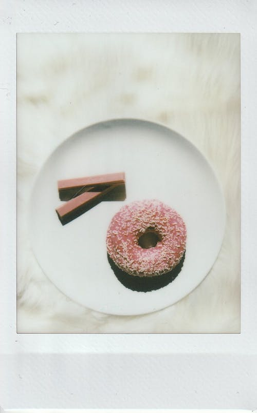 Pink Donut and Chocolate on Plate