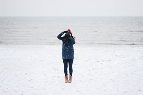 Woman Taking Picture on the Beach View