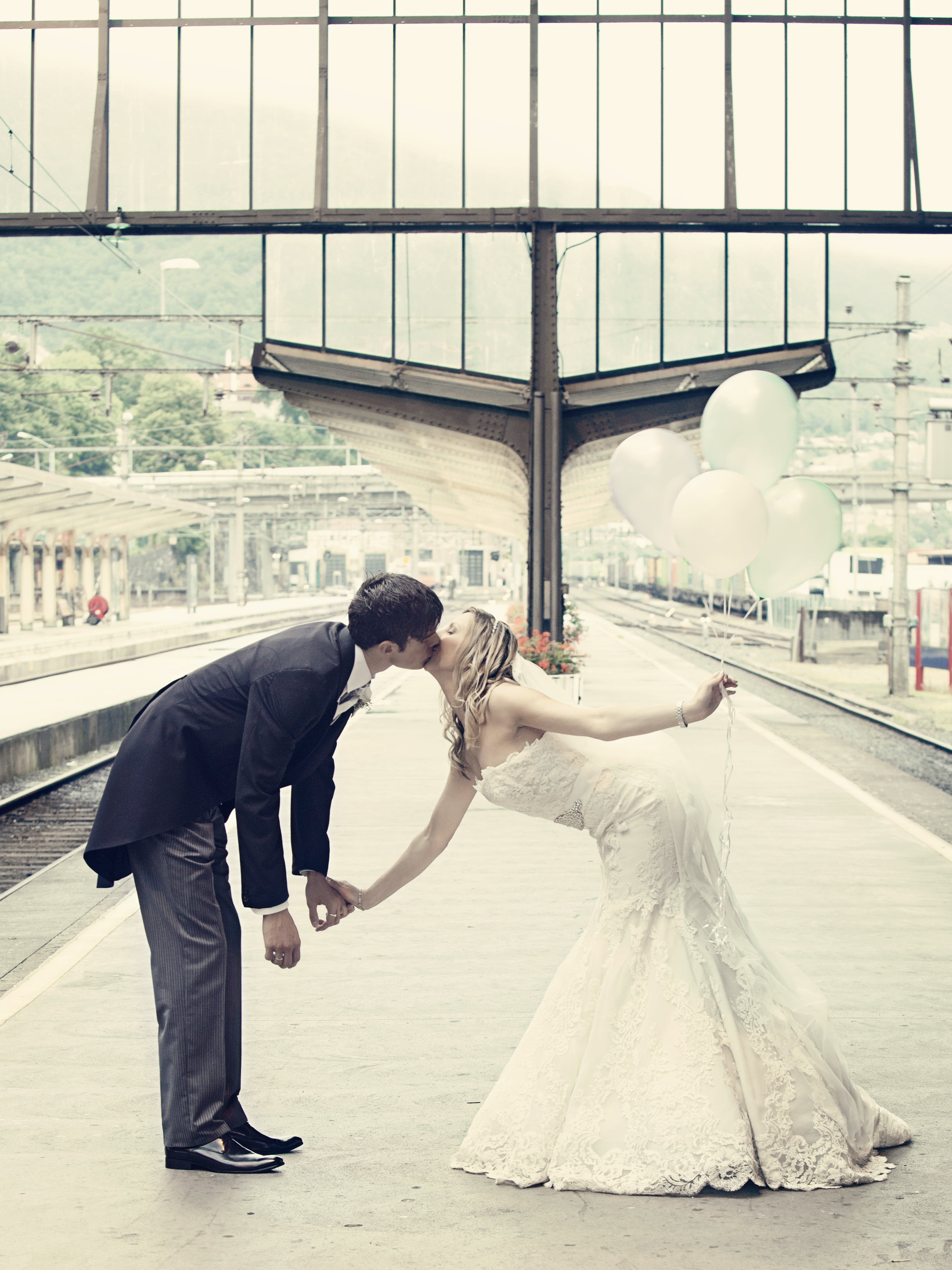 Couple Kissing Standing on the Train Waiting Platform