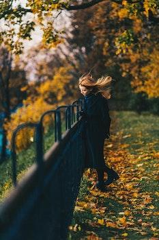 Woman Wearing Black Coat Near Railings