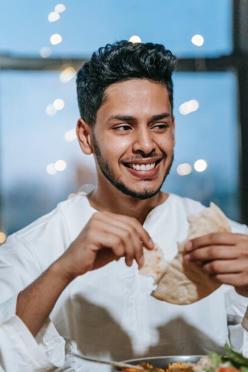 Man Eating White Bread