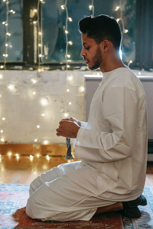 Man in White Thobe Praying