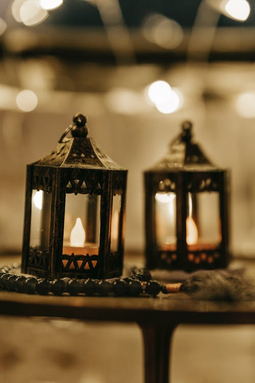 Decorative candles placed in metal candleholders in room