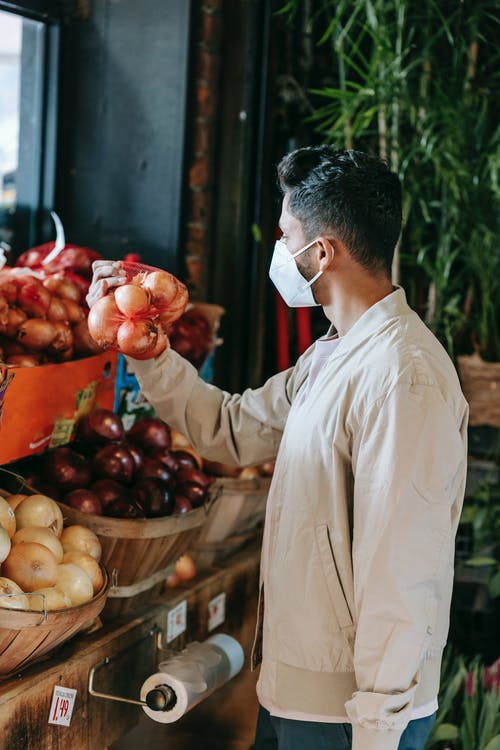 Ethnic man choosing goods in grocery market