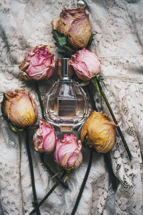 Dried flowers composition with perfume bottle