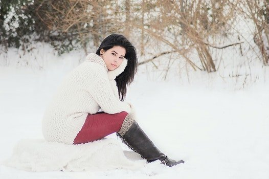 Woman In White Sweater Sitting Near Grass During Winter Season