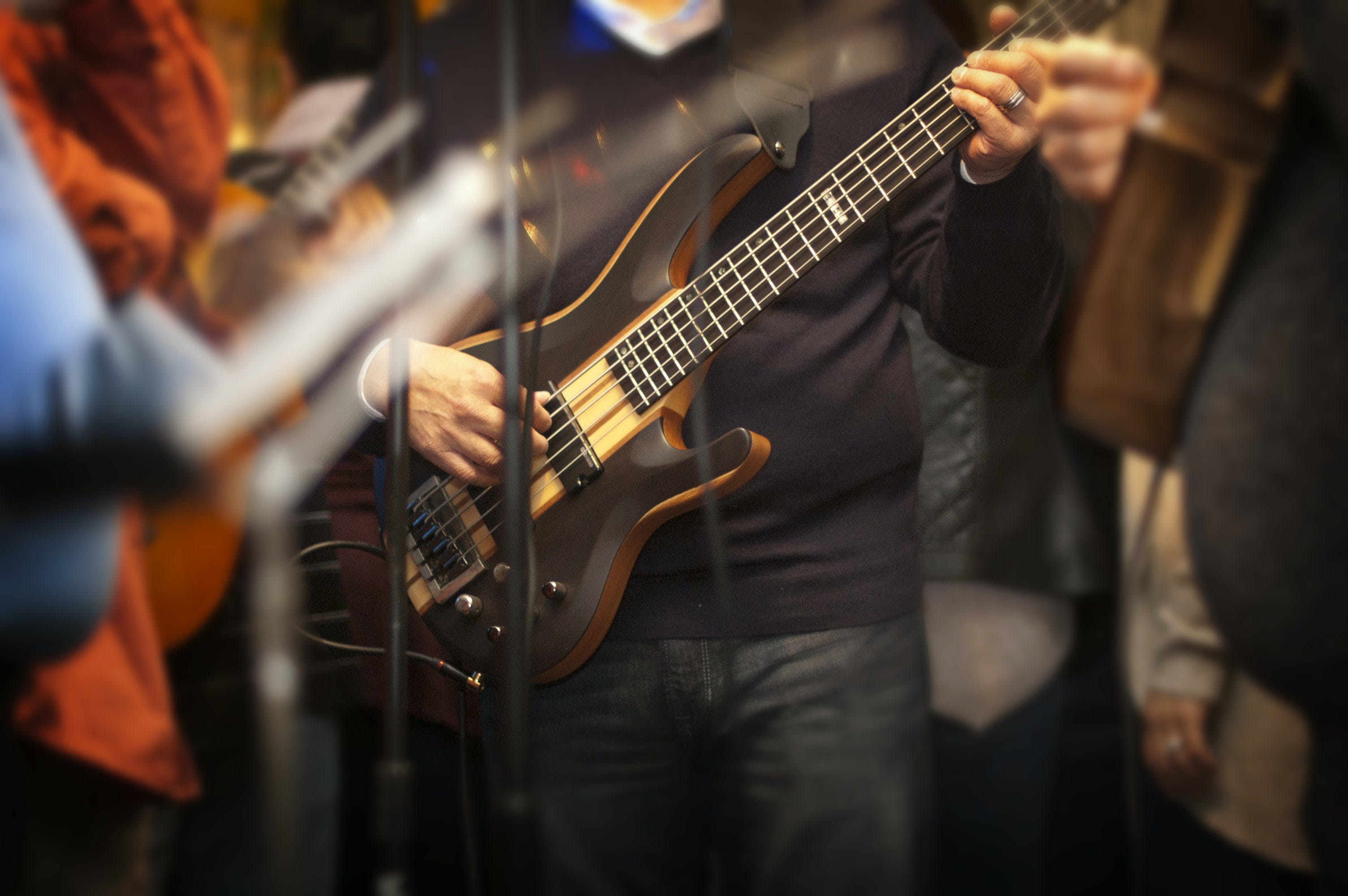 Man Holding Electric Bass Guitar