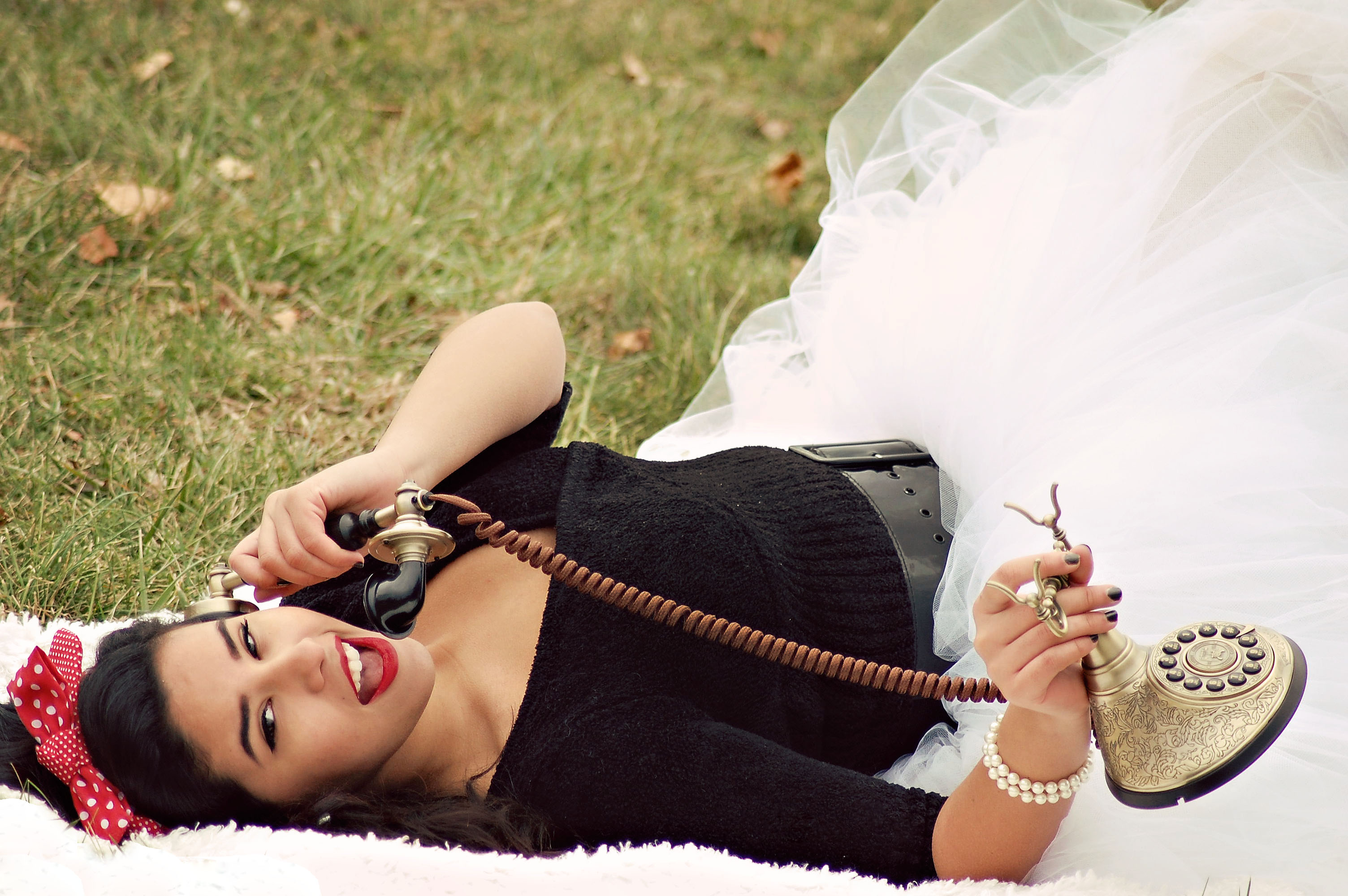 Woman In Black And White Tutu Dress Holding Cradle Phone
