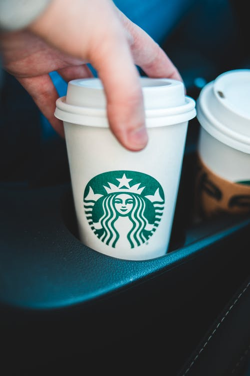 A Person Holding a Starbucks Cup