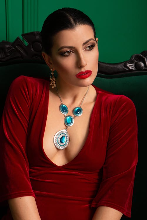 Fashionable woman in dress with necklace