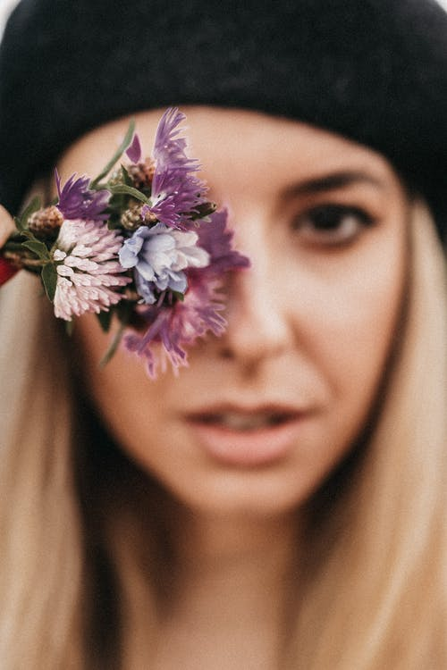 Charming woman with bright flowers