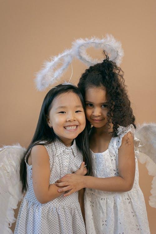 Smiling Asian girl standing near black friend