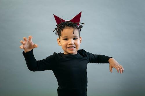 Black boy in devil costume