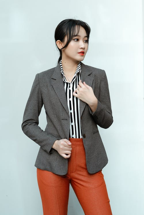 Woman in Gray Blazer and Red Skirt