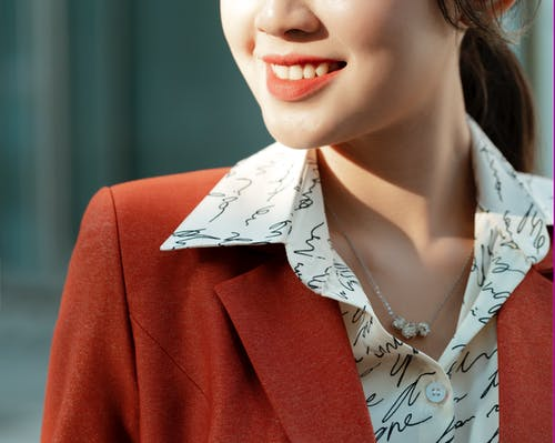 Woman in Red Blazer Smiling