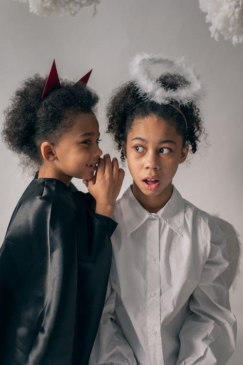 Children in Halloween costumes in studio
