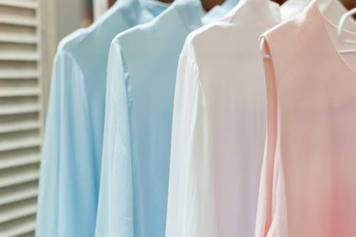 Row of assorted clothes for women in shop