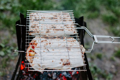 Process of grilling meat and vegetables in lavash
