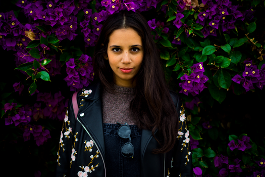 Woman Standing Near Purple Flowers