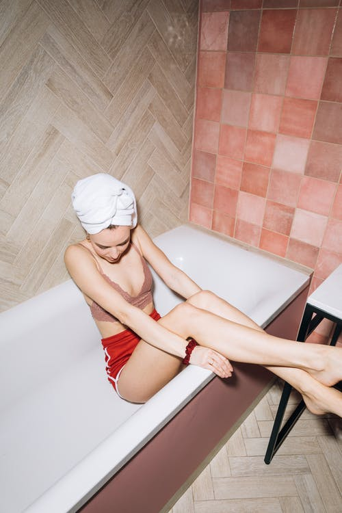Young Woman Sitting in a Bathtub