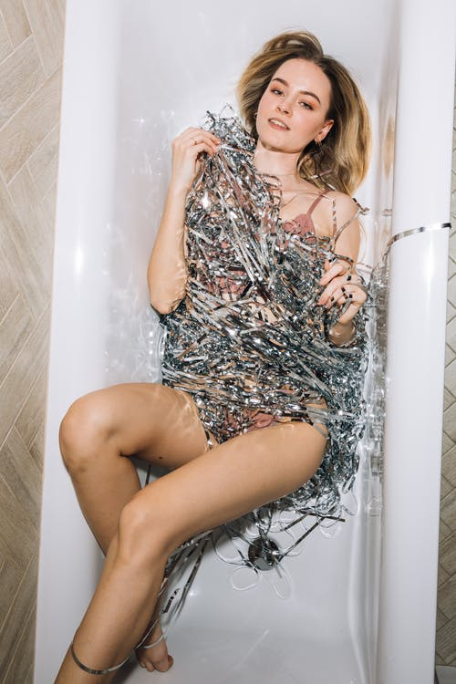 Girl Smiling While Lying Down in a Bathtub