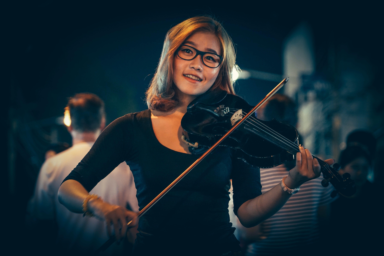 Woman Playing Black Violin