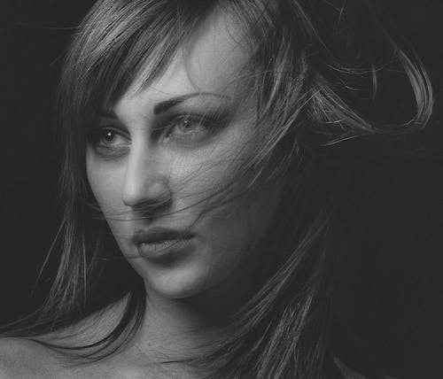 Woman's Face in Grayscale Photography
