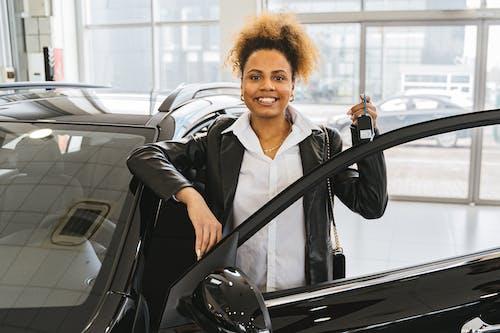 Woman in Black Blazer Holding Car Keys Smiling