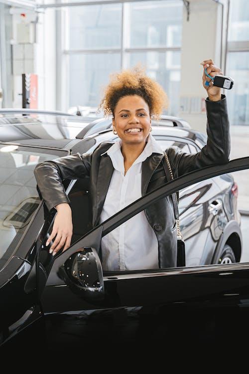 A Woman Holding a Car Key