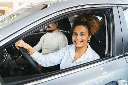 Smiling Woman Sitting Inside the Car