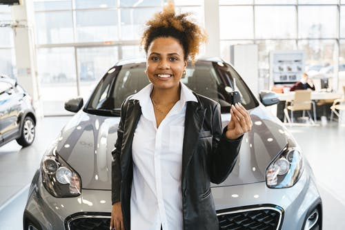 Smiling Woman Bought a Brand New Car