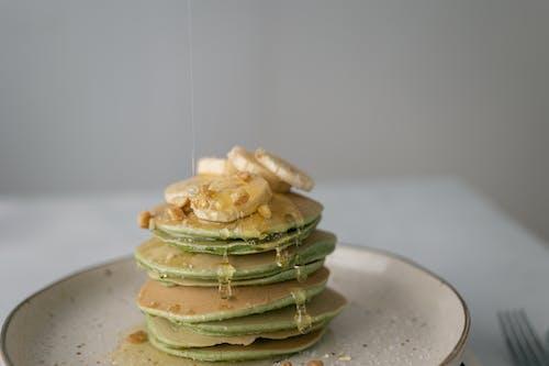 Tasty pancakes with sweet fresh banana on top