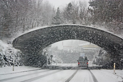 Photo of White Vehicle Crossing a Tunnel