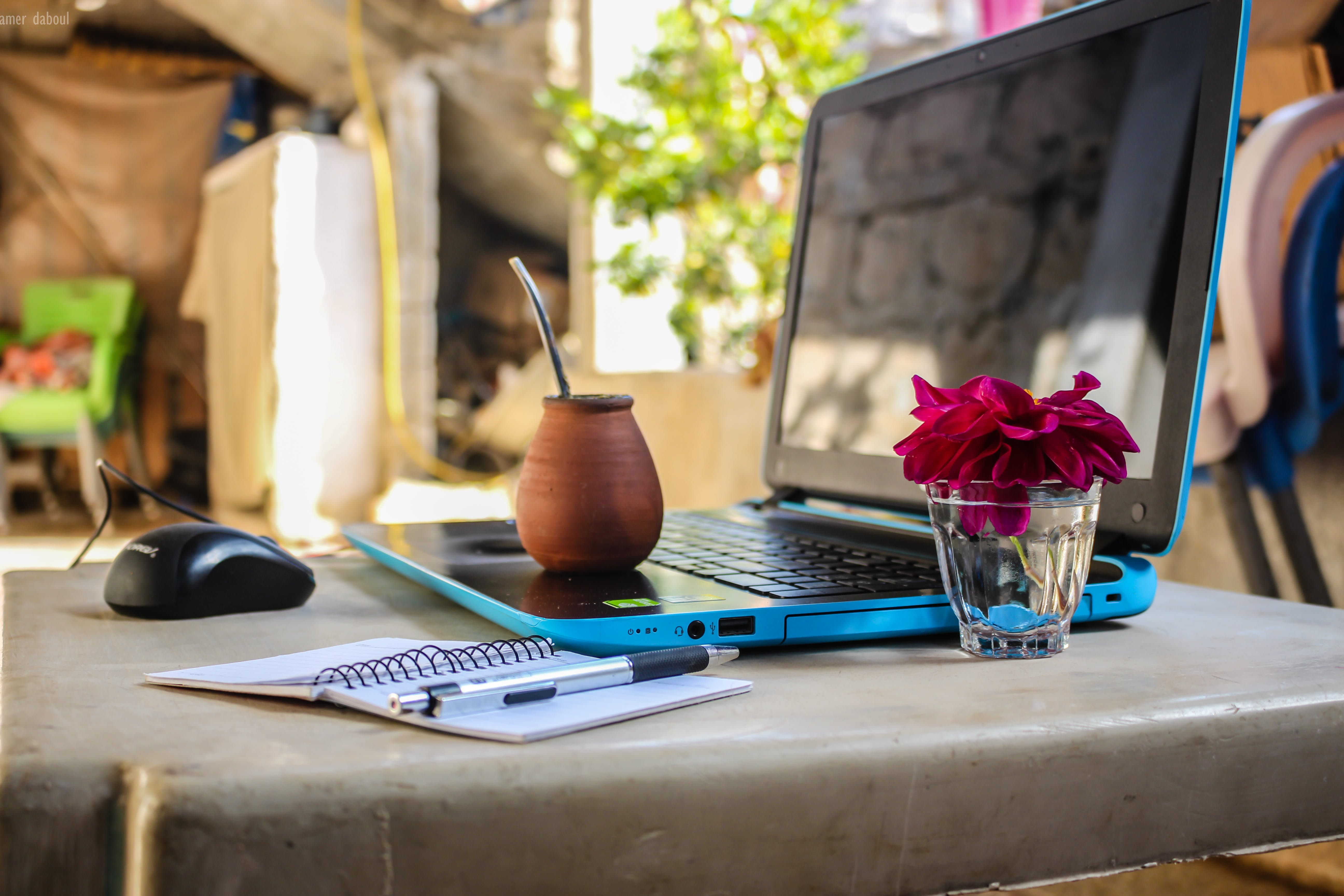 Brown Clay Pot On Black And Blue Laptop