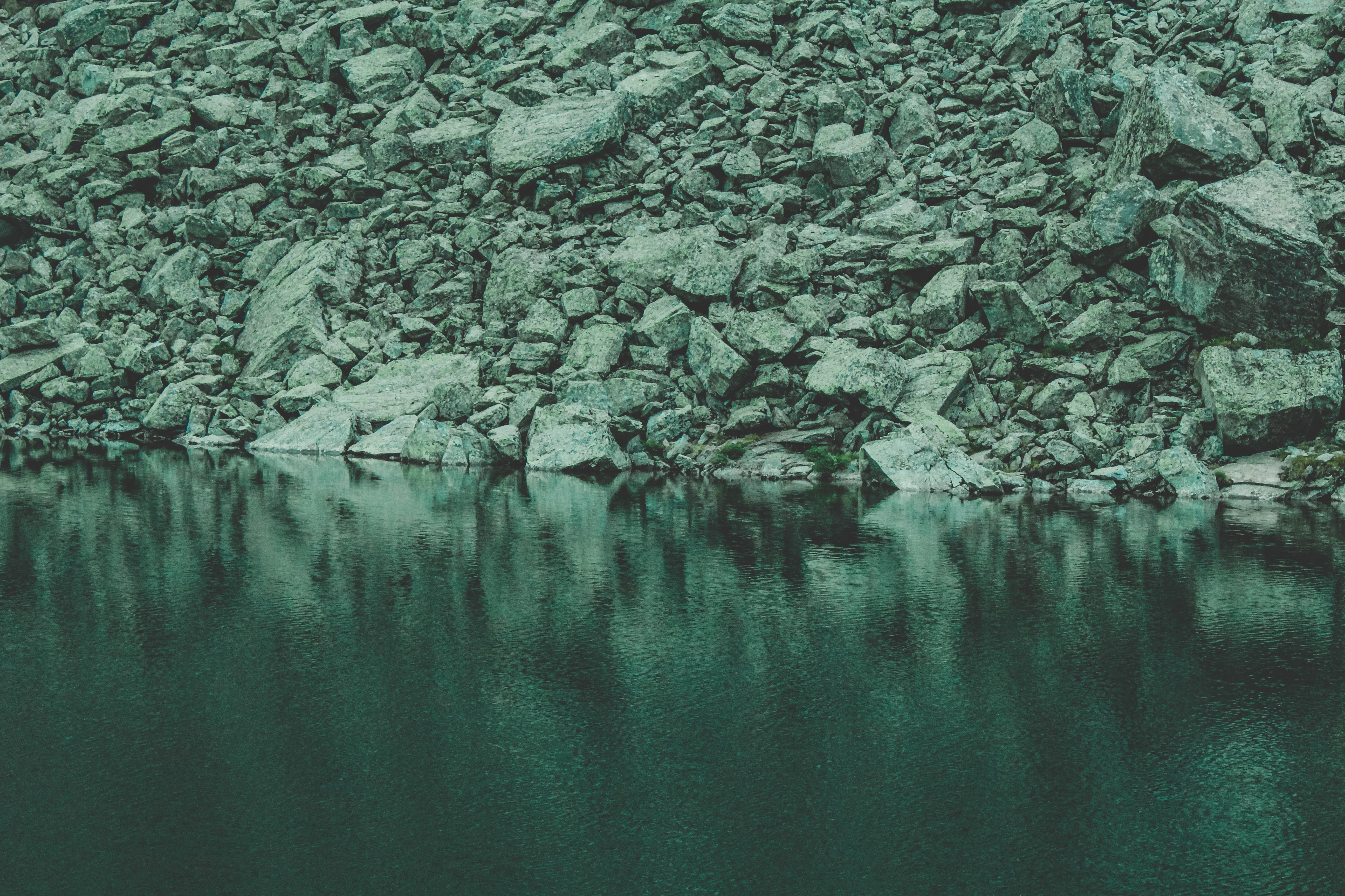 Rocks Near Calm Body Of Water
